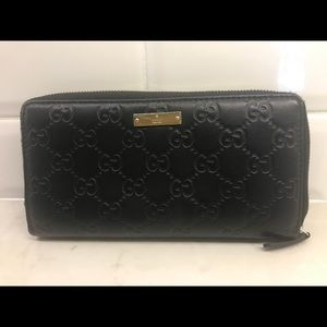 Gucci GG Zippy Black Leather Monogrammed Wallet